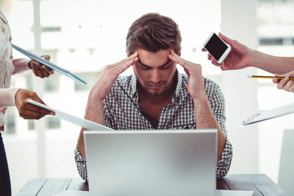 Businessman stressed out at work over email